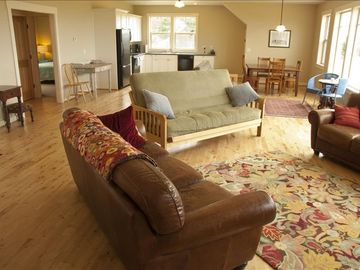Cannon Beach house rental - Living room looking towards dining room and kitchen.