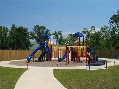 Playground adjacent to the pool and located outside your garage!