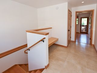 Truckee house photo - Clean entryway with heated floors. Bench for sitting down and putting on shoes