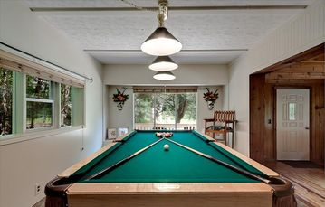 Enjoy a game of pool, foosball or playstation in your creekside cottage