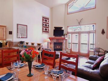 Old Town condo rental - Living Room, overlooking Main Street, 25-foot ceiling and beautiful fire place.
