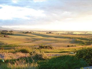 Bozeman house photo - Golden plains. One of our many views along with sunsets of purple & pink.