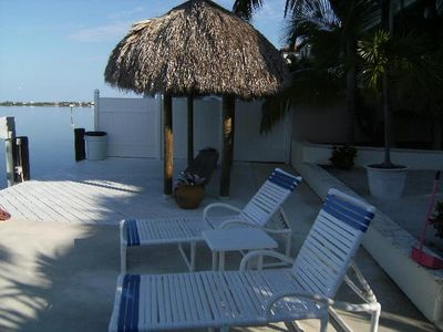 Lounge by the ocean in the lounge chairs or under the Indian tiki hut