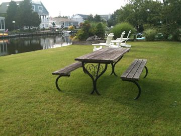 Dine outside while watching the boats go by, or relax in Adirondack Chairs