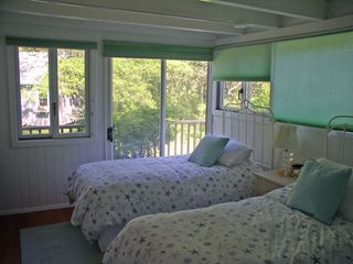 Chilmark house photo - the 1st floor twin BR w/ sliders and the deck, notice bike shed outside