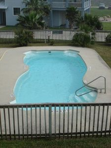 View of swimming pool from balcony.