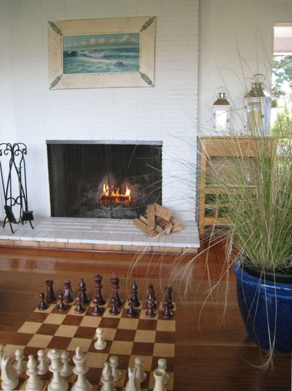 Enjoy some chess in front of the wood burning fireplace.