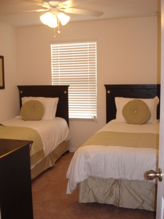 Bedroom 2 - two twin beds, ceiling fan, TV, dresser