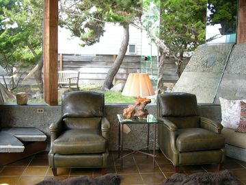 Comfortable leather chairs in living area.