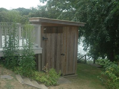 Enclosed outdoor shower with hot and cold water