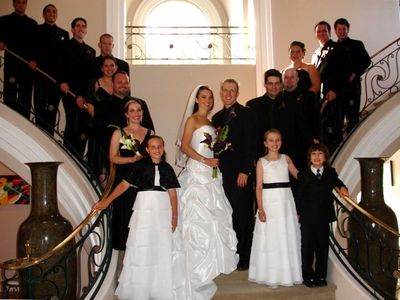 Bridal party poses for photos on the Grand Entry staircase