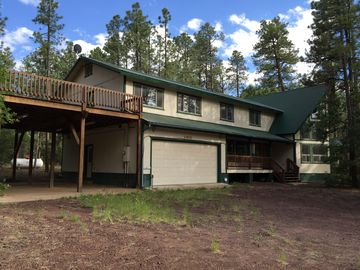 Pinetop house rental - Front View showing large deck with carport and full garage