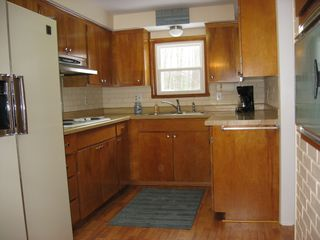 Hillman cottage photo - Kitchen with stovetop and wall oven.