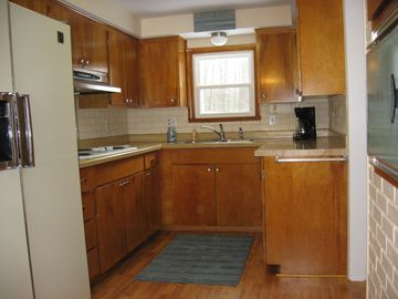 Kitchen with stovetop and wall oven.