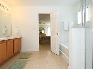 Windwood Bay villa photo - Master bathroom with dressing room behind