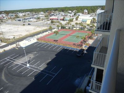 View of tennis courts from deck -- tennis racquets in condo and at office