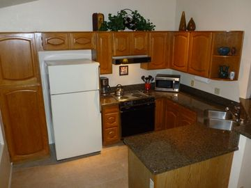 Remodeled Kitchen with Granite Counters and Tile Floor