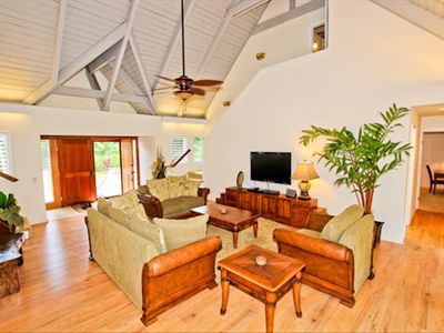 Beautiful living area with hardwood floors and high ceilings!