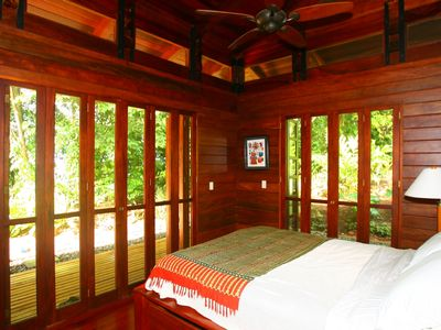 La Selva Verde has a queen bed, ceiling fan, wrap around deck and private bath.