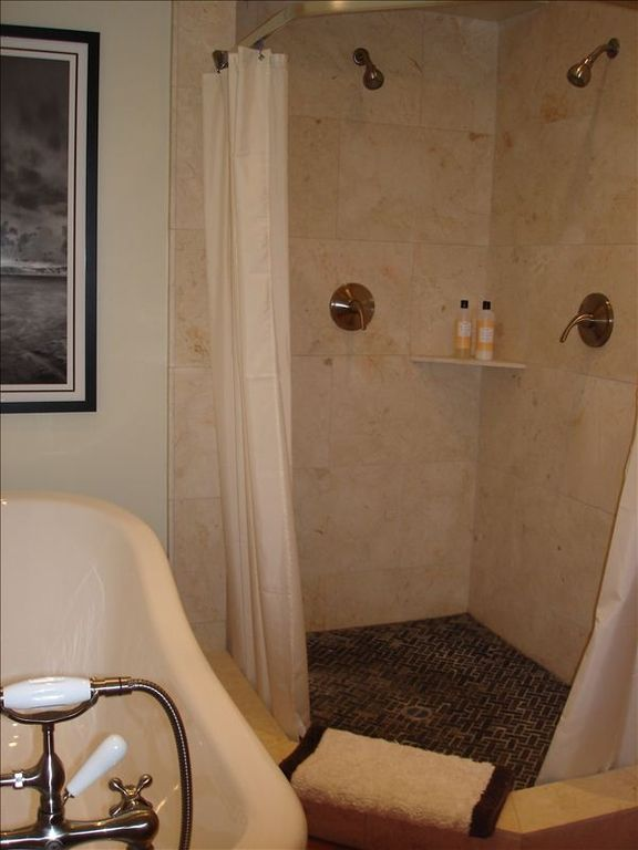 Master bath: Soaking tub and natural stone double shower.