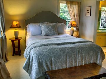 One of Two Bedrooms with Plush Beds and Luxurious Linens