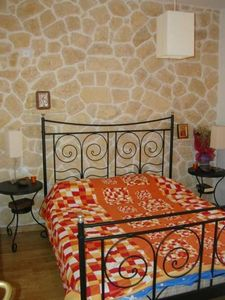 Inlaid Stone walls in the bedroom.