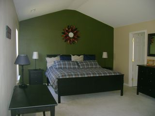 Shawnee house photo - Bedrooms with a theme: Autumn room, master bedroom with king size bed and desk.