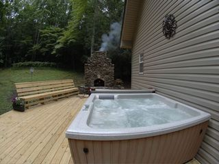 Clayton cabin photo - Unwind by taking a soak under the stars