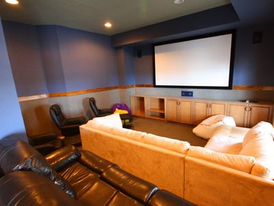 "Theatre Room- 110"" screen with bluray, surround sound and stadium seating for 15"