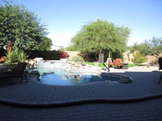 Scottsdale house photo - Back yard oasis with putting green, fire pit and built in bbq.