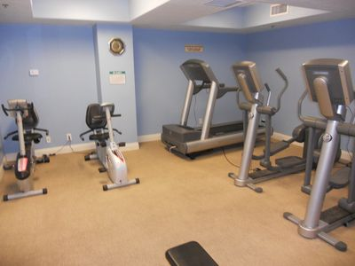 Calypso fitness room complete with treadmills, eliptical trainers & free weights