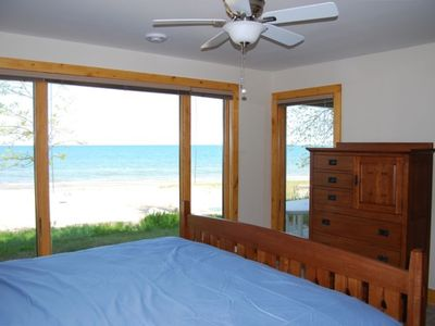 Master bedroom with king bed overlooking the beach and lake.