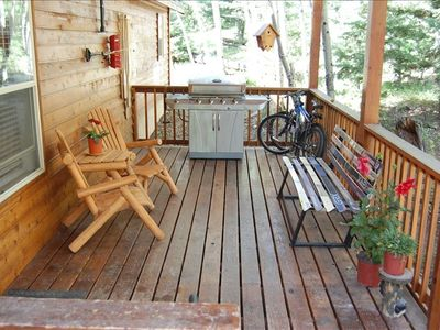 Covered Back Deck with Barbeque Grill, Cedar Furniture, and Ski Bench