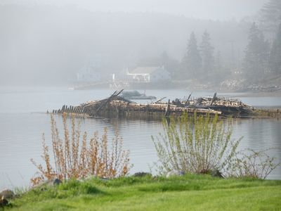 Boothbay Harbor condo rental - Hazy morning view from just outside the LR of abandoned ships' hulls from 1940s
