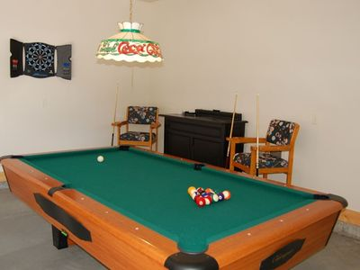 Pool table and dart board