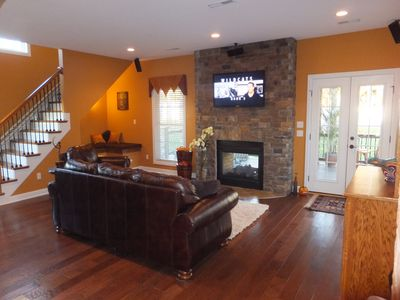 Hearth room with see thru fireplace..stairs go up to mother-in-law suite