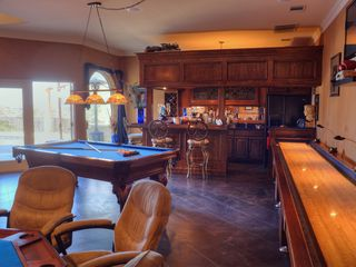 Austin estate photo - Villa Game Room w/ pool table, full-size shuffle board, and 8 person poker table