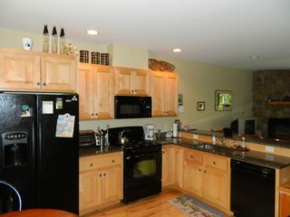 Carrabassett Valley condo photo - Kitchen from the entryway; coffee maker, toaster oven, microwave; fully supplied