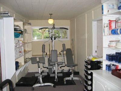 Fully functional gym with tredmill, semi new weights, and work out equipment.
