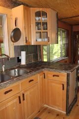 Blairsville cabin photo - Lots of details in kitchen with log cabinet pulls