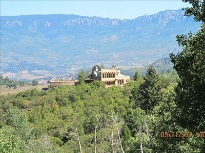 Ridgway villa rental - The adobe sits atop a hill. The Cimarron Range provides a dramatic east backdrop