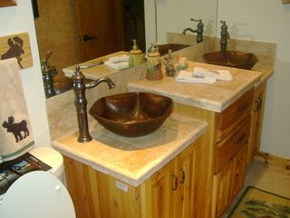 Walker cabin photo - Guest bath with double sinks and heated floors.