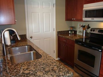 Fully equipped kitchen with stainless appliances