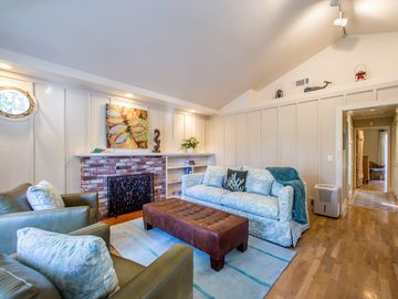 Carmel house rental - Living room offers vaulted ceilings, bay window and cozy gas fireplace.