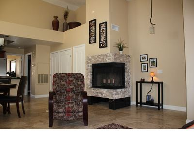 Great room with vaulted ceilings and corner fireplace