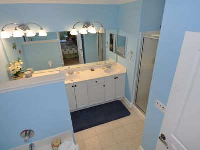 Master Bath with Shower and Spa Tub.