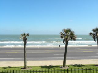 Galveston condo photo - Enjoy watching the waves from our balcony on a beautiful day in Galveston.