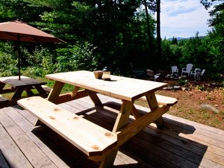 Lincoln cottage photo - Exterior deck with two picnic tables