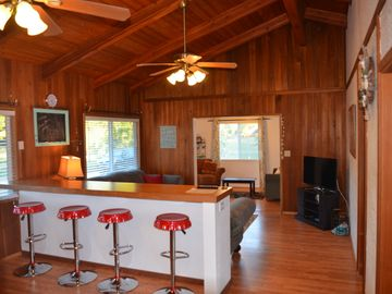 Mokuleia house rental - Kitchen Bar to Front Room. Entry Background.