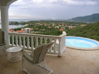 Playa Cofresi villa photo - jetted hot tub with views to the city and beyond